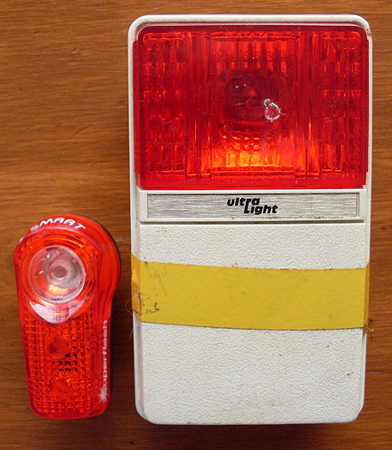 Current day Super Flash tail light beside a old Ultra Light tail light