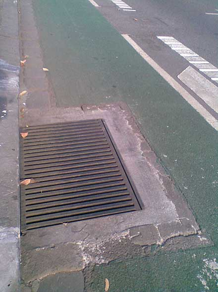 Photo showing a drain cover that has been modified to make it less of a crash hazard for cyclists.